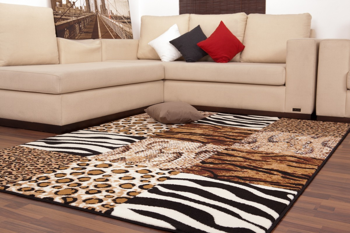 tapis contemporain de couleur beige et aux motifs convers. Black Bedroom Furniture Sets. Home Design Ideas