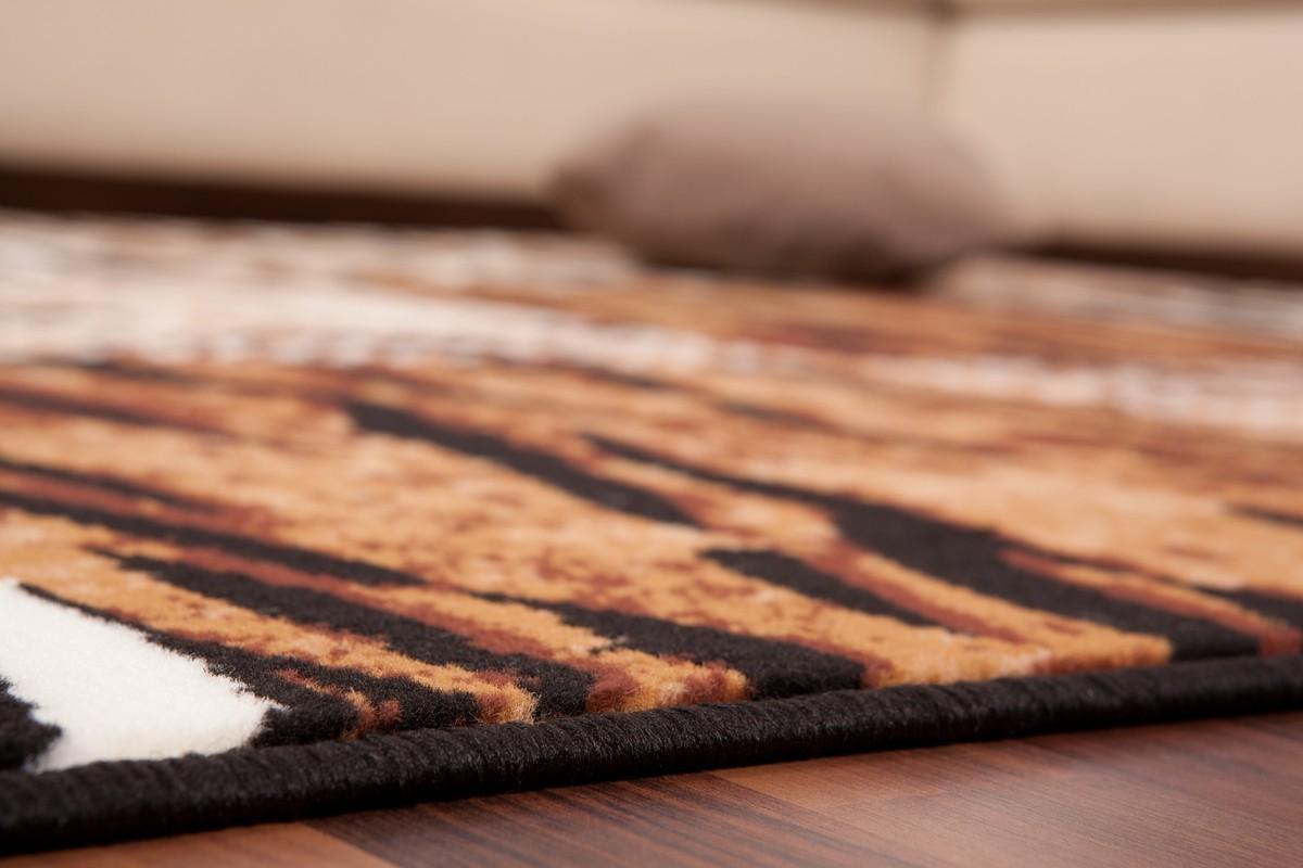 tapis contemporain de couleur beige et aux motifs convers. Black Bedroom Furniture Sets. Home Design Ideas
