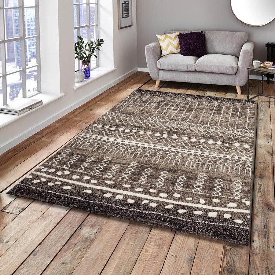 tapis salon marron tapis de salon moderne petitgrand taille marron uni poil ras tailles with. Black Bedroom Furniture Sets. Home Design Ideas